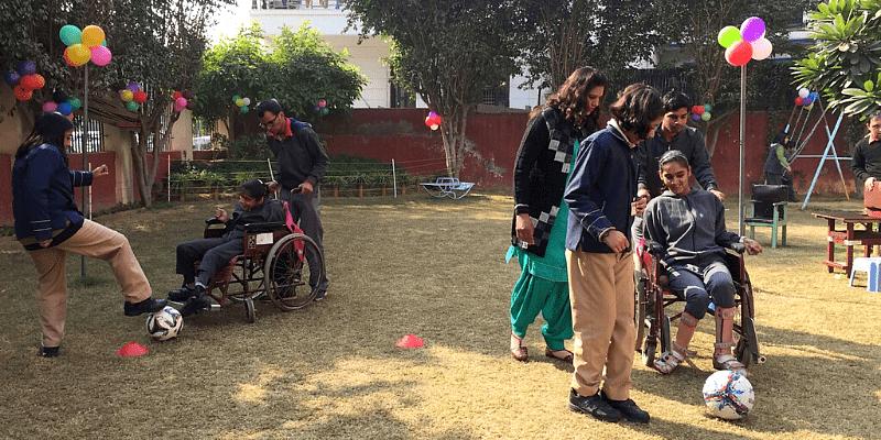 Children playing customized wheelchair basketball.