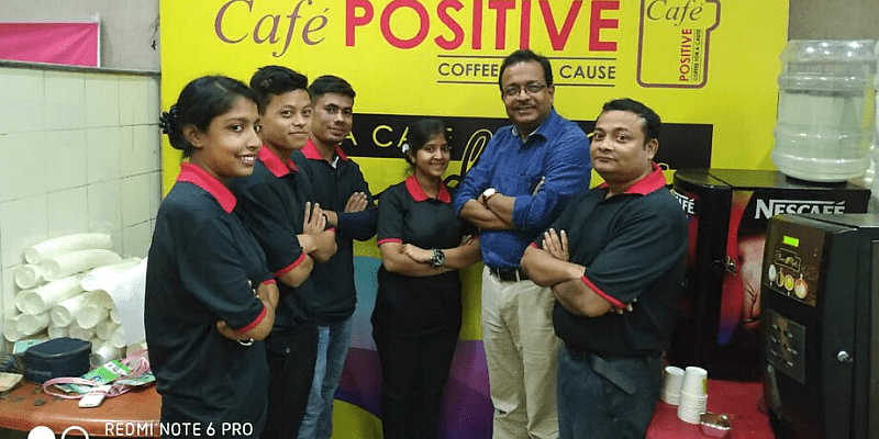 Kallol Ghosh with some young adults working at Cafe Positive
