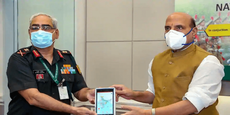 Rajnath Singh with NCC DG Lt Gen Rajeev Chopra while launching a mobile training app for NCC cadets in New Delhi on Thursday.  (Photo courtesy: PTI)