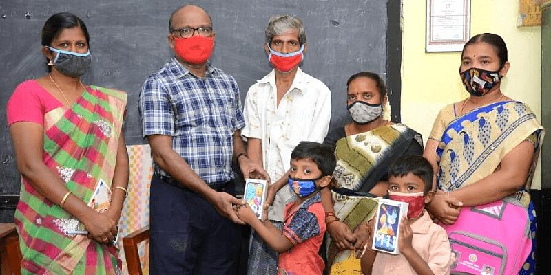 Headmaster K Jayakumar Gyanraj is giving smart phones to the children in his school.  Photo courtesy: The New Indian Express