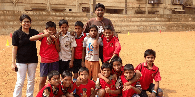 Aditya with some students in the playground.