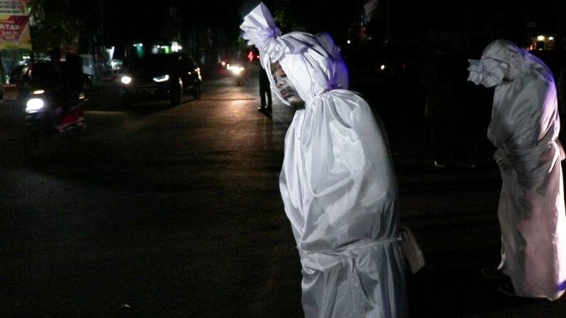 The 'ghost' roaming the streets in Indonesia has been entrusted with scaring people, but why?